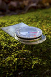 Compass. Sitting on a moss covered rock Royalty Free Stock Image