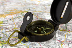 Compass. Close-up of a compass on a road map Stock Images