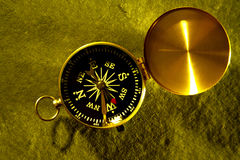 Compass. Navigation compass on a textured background Stock Photos