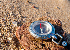 Compass. On the sand. Abstract composition Stock Photo