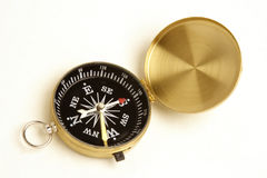 Compass. A close up view of navigation compass  isolated on white back ground Royalty Free Stock Images