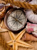 Compass. Adventure decoration with compass and rope Stock Photography