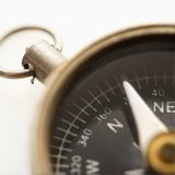 Compass. Detail of compass pointing northeast