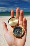 Compass. In hand. Beach in background Stock Photography