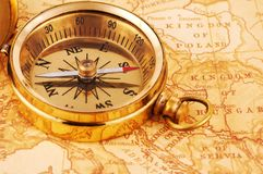 Compass. Photo of a Compass on a Map Stock Image