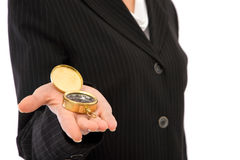 Compass. Business concept with businesswoman holding golden compass Royalty Free Stock Image
