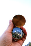 Compass. A brass compass in a hand pointing Stock Photos