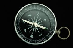 Compass. A single compass on black background with the pointer point to the south direction royalty free stock images
