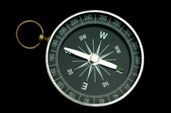 Compass. A single compass on black background with the pointer point to the north direction stock photo