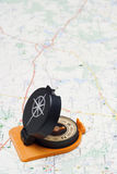 Compass. On a map as a background royalty free stock photo