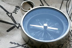 Compass. Mining compass on the map Royalty Free Stock Images