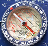 Compass. Close up of a compass on a map of Romania Royalty Free Stock Image