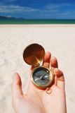 Compass. In hand. Beach in background Stock Images
