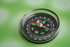Compass. On green background Stock Photo