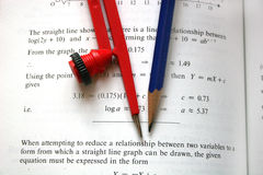 Compass. And pencil on maths text book Royalty Free Stock Photo