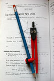 Compass. And pencil on mathe text book Royalty Free Stock Images