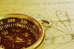 Compass. Brass compass over an old da Vinci drawing stock image