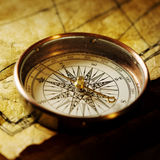 Compass. Close up view of the Compass on the old paper background Royalty Free Stock Photos