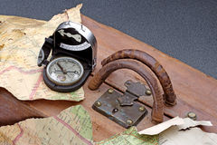 Compass and adventure. A concept image about travels and adventure Royalty Free Stock Image
