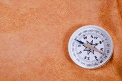 Compass against the skin Stock Images