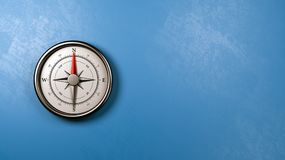 Compass Against a Wall with Copyspace. Metallic Compass with Red Magnetic Needle Pointing Toward the North Against a Plastered Blue Wall with Copyspace, 3D royalty free illustration