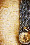 Compass, anchor and  chain on vintage old paper. Background Stock Photography