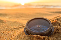 Compass. Ancient compass on the sand at the Beach Sunrise ,nature background Stock Images