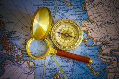 Compass And Magnifying Glass Stock Photo