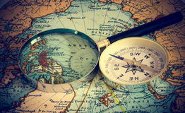 Compass And Magnifying Glass Stock Photos
