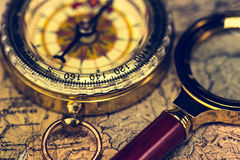 Compass And Magnifying Glass Stock Images