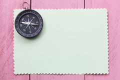 Compass And Note Paper On The Pink Wooden Floor. Royalty Free Stock Photos