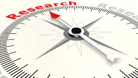 Compass with arrow pointing to the word research Royalty Free Stock Photography