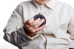 Compass in baby's hand. Isolated compass in baby's hand  on a white background Royalty Free Stock Images