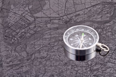 Compass on the background of the reflection maps Royalty Free Stock Images