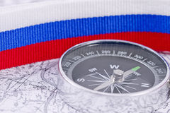 Compass on the background of the Russian flag Stock Photo
