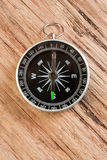 Compass on the background of the wooden planks Stock Images