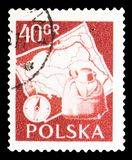 Compass and backpack, map of Poland, Polish Tourist industry serie, circa 1956. MOSCOW, RUSSIA - SEPTEMBER 15, 2018: A stamp printed in Poland shows Compass and royalty free stock images