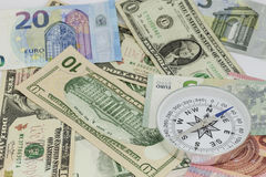Compass on banknote for financial direction,concept of business Stock Photos
