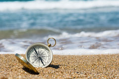Compass on the beach. Compass on the golden sand by the sea Stock Photo
