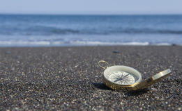 Compass on the Beach Stock Photo