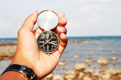 Compass in a beach Stock Photos