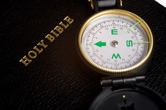 Compass on Bible. An engineers directional compass on a Bible, concept of guidance or direction Stock Image