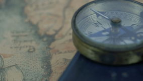 The compass and the bible on the map stock video footage