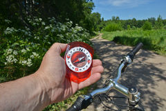 Compass and bike. Royalty Free Stock Photography