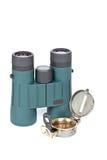 Compass and binoculars Stock Photo