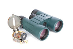 Compass and binoculars Royalty Free Stock Photos