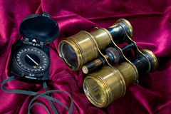 Compass and binoculars Royalty Free Stock Images
