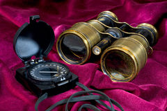Compass and binoculars Stock Photo