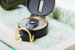 Compass and binoculars on map closeup Royalty Free Stock Photography