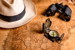 Old map with compass and binoculars Royalty Free Stock Photos
